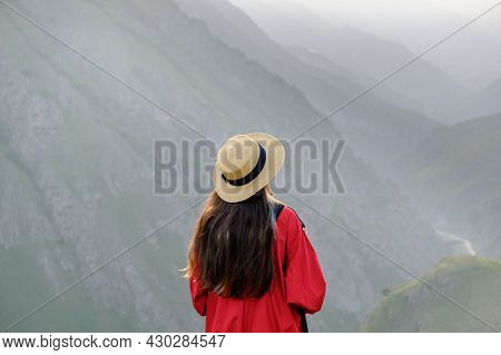 Young Girl With Long Hair And A Hat Enjoying A Beautiful Mountain Landscape Wanderlust And Travel Co