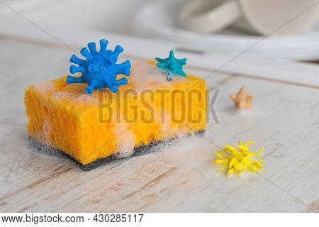Viruses And Germs On The Dishwashing Sponge. Concept Change The Sponge More Often.