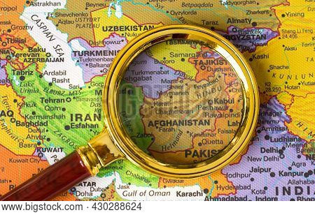 Lviv Ukraine-08 19 2021 : Afghanistan A Map Of Asia In A Defocused Magnifying Glass, The Theme Of Tr