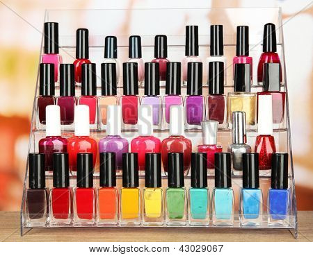Bright nail polishes on shelf in beauty salon