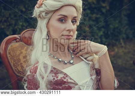 Portrait Of Blonde Woman Dressed In Historical Baroque Clothes