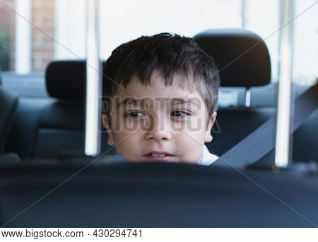 Close Up Face Of Cute Boy Siting In Safety Car Seat Looking Out With Smiling Face,child Sitting In T