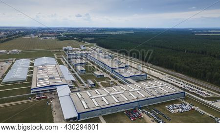 Modern Exterior Of Industrial Complex At Daytime. Aerial View Of Manufacturing Structure With Parkin
