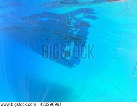 Underwater view to yacht rudder and prop, scuba diving concept. Aegean Sea. Near Marmaris, Turkey