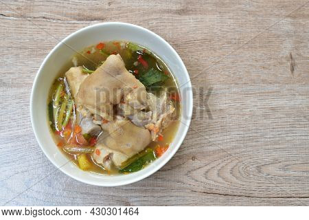 Boiled Spicy Pork Leg In Tom Yum Soup On Bowl