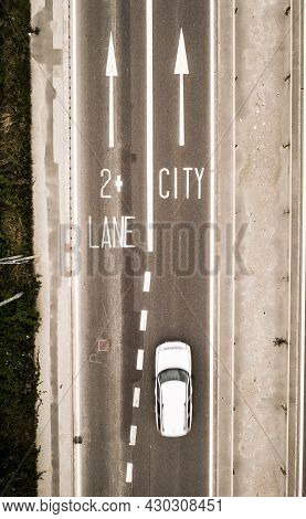 Aerial View Of A Dual Carriageway Road Sign Directing Traffic Towards A City With Traffic Calming Me