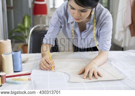 Fashion Designer Working In Atelier.