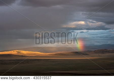 Amazing Bright Colorful Rainbow Over The Hills In The Steppe Among The Mountains, Rain And Rays Of S