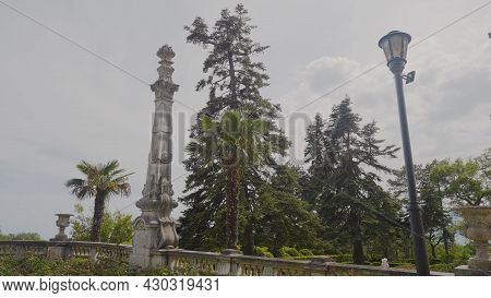 Historical Pillar In Park In South. Action. Beautiful Park With Ancient Memorial Pillars Made Of Sto