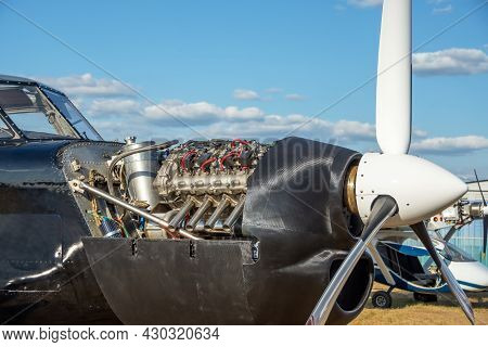 Light Engine Aircraft With An Open Engine Hood, The Device Is The Mechanism Of Operation Of The Engi