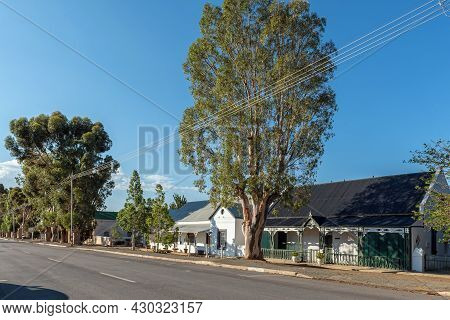 Prince Albert, South Africa - April 20, 2021: A Street Scene, With Historic Houses, In Prince Albert
