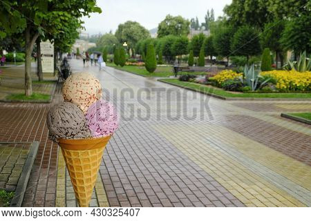 A Big Ice Cream Figure. Advertising Shape Of Ice Cream Stands On The Street To Attract Customers To