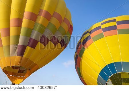 Colorful Yellow And Red Hot Air Balloons Over Blue Sky In California