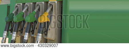 Panoramic Banner Pump Nozzles At The Gas Fuel Station. Gasoline Dispenser On Petrol Station. Guns Fo