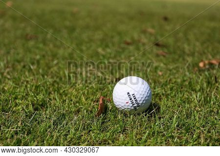 Minsk. Belarus - 25.07.2021 - Golf Ball On A Green Grass Background