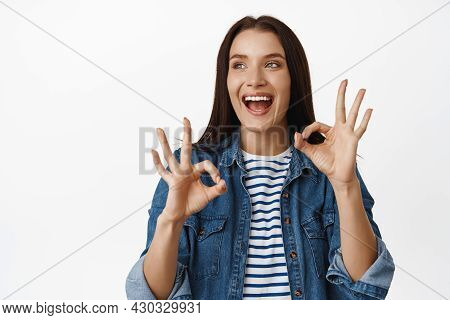Happy Adult Woman Rate Smth Cool, Recommending, Looking At Sale And Smiling Pleased, Make Ok Okay, Z