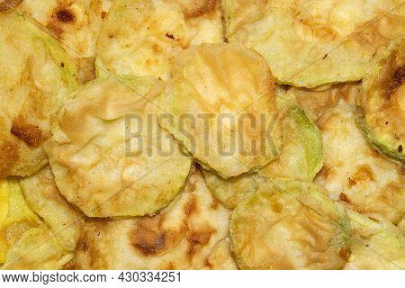 Zucchini Fried In Sunflower Oil.fried Zucchini Background.