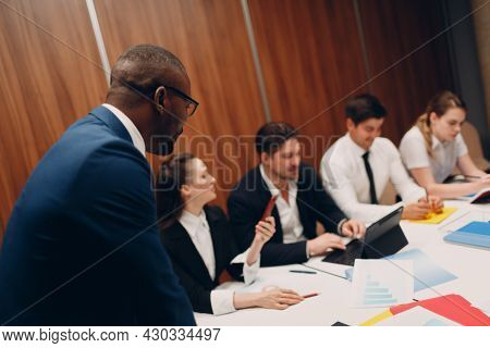 Businessman African Boss And Businesswoman Team At Office Meeting. Business People Group Conference