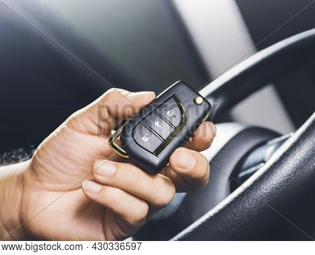 Car Keyless Entry Remote In The Owner Hand On The Car