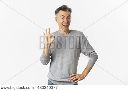 Image Of Handsome And Cheerful Middle-aged Man Showing Support, Make Okay Sign And Smiling Satisfied