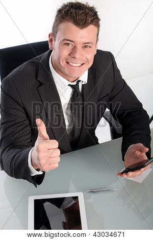 Enthusiastic Young Businessman Showing Thumb Up