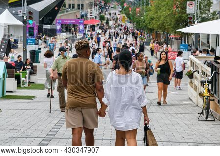 Montreal, Ca - 17 July 2021: People Walking On Sainte Catherine Street At The Place Des Arts.