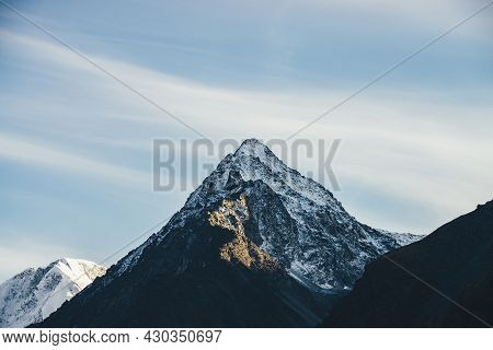 Sunny Landscape With Great Mountains Silhouettes And Snow-covered Pointy Peak With Golden Sunshine O