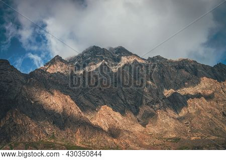Mountain Landscape With Rocks In Golden Sunlight And Low Clouds. Awesome Rocky Wall With Sharp Top I