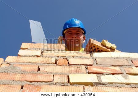 Mason With Brick And Trowel