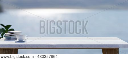 Copy Space On Marble Stone Table Top, Blurred Lake Landscape In The Background