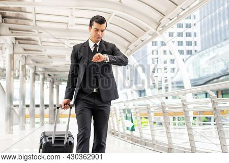 Business Man Wearing A Suit With A Suitcase Carrying A Luggage , He Had A Worried Look On His Face ,