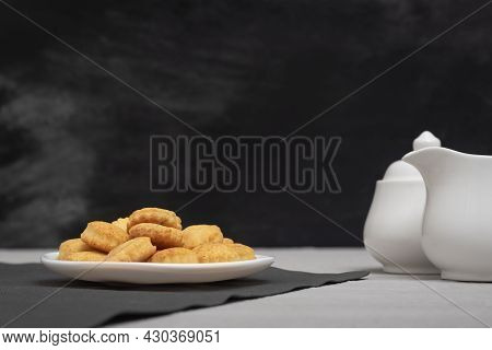 Homemade Cookies On The Plate. Black Background, Creamer And Sugar Bowl. Baking For Tea. Delicious B