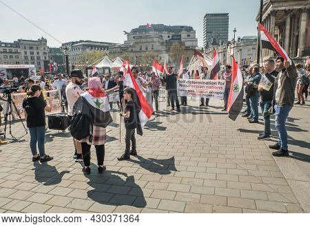 London, United Kingdom - Apr 19, 2019 : View Of People With Placards And Syrian Flag On Global Strik