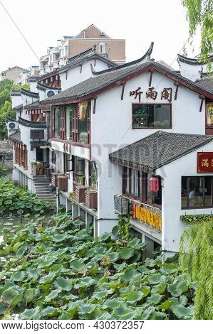 Shanghai, China - September 2019: Traditional Chinese Teahouses And Buildings Along The Riverbank Of