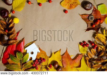 Selective Focus White Decorative Houses With Autumn Leaves, Chestnuts, Rowan, Acorns On A Beige Back