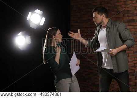 Professional Actors Rehearsing On Stage In Theatre