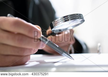 Businessman Finance Investigation Using Magnifying Glass. Fraud And Audit