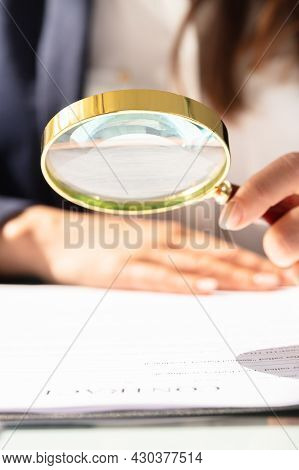 Businesswoman Investigation Finance Using Magnifying Glass. Fraud And Audit