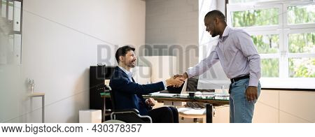 Employee Disability At Workplace. Hand Shake In Office