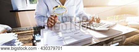 Professional Auditor Fraud Investigation Using Magnifying Glass