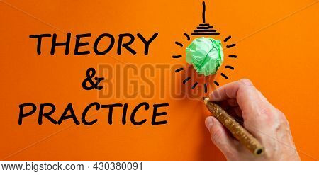 Theory And Practice Symbol. Businessman Writing Words 'theory And Practice', Isolated On Beautiful O