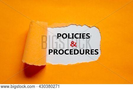 Policies And Procedures Symbol. Words 'policies And Procedures' Appearing Behind Torn Orange Paper.