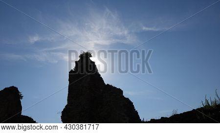 Ruin Of Boskovice Castle In The Czech Republic. Silhouette Of A Wall Of Boskovice Castle With Bush
