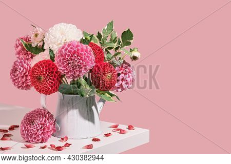 Autumn Bouquet Of Beautiful Dahlias Flowers And Petals On White Table. Autumn Festive Decoration In