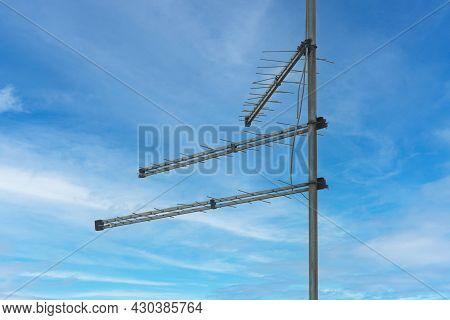 Three Obsolete Antennas At Pole For Analog Tv Signal