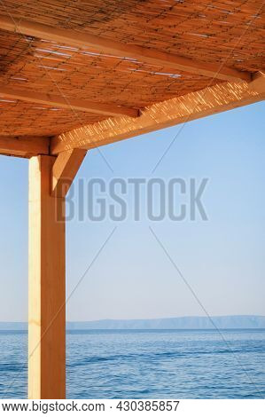 Rest And Comfortable Summer Vacation On The Sunny Coast. Straw Bungalow On The Croatian Seaside.
