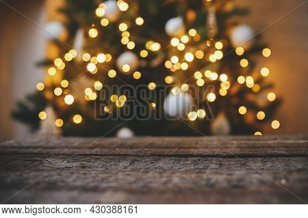Christmas Background. Rustic Wood On Background Of Christmas Tree  Lights Golden Bokeh. Space For Te