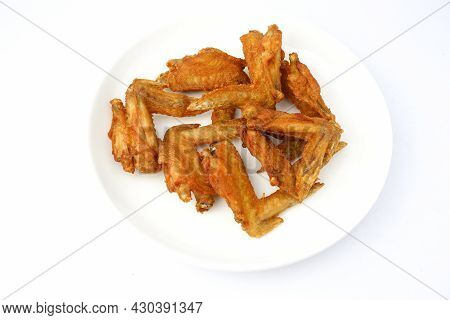 Delicious Fried Chicken Wings On White Plate On White Background