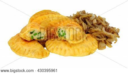 Group Of Potato And Cheese Filled Pierogi Dumplings With Fried Onions Isolated On A White Background