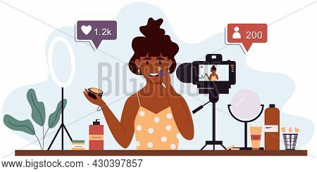 Popular Woman Video Blogger Records A Video Review Of Cosmetics Using A Video Camera And A Light Lam